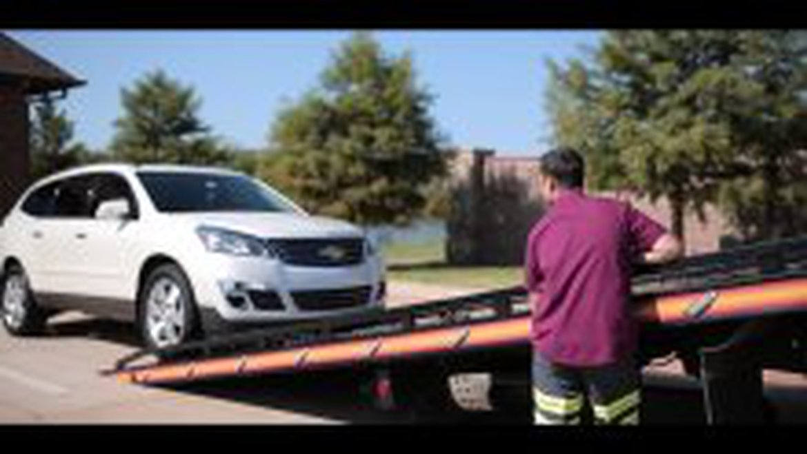 Car Being Towed for a Charitable Donation